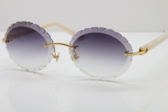 Cartier Rimless T8200761 Sunglasses In Gold Gray Carved Lens