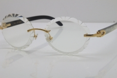Cartier Rimless Original White Inside Black Buffalo Horn T8200761 Eyeglasses in Gold Transparent Carved Lens